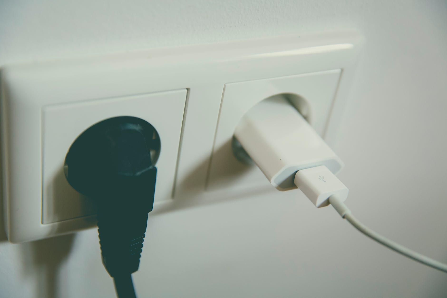 black socket on white switch besides white socket converter